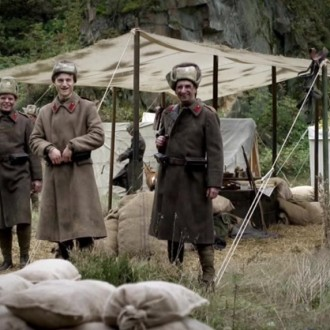 Oleg Tikhomirov as Bogdan Aristov and others in episode 7 of Small Hands in a Big War (© Looks Film & TV).