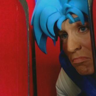 Nick Fleuren als Strongo in aflevering 2 van Sportlets (© Workout Factory BV)